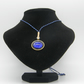 Golden alloy, Black resin, Blue pebble adjustable necklace.