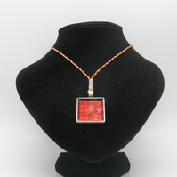 Silver alloy, Red resin, Red and Orange Star Glitter