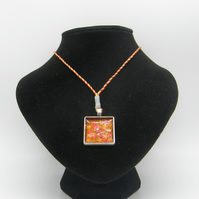 Silver alloy, Orange resin, Orange and Red Star Glitter