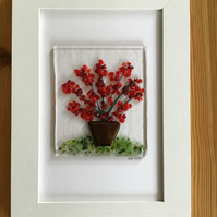 Red flowers in tub fused glass picture, 6x4 frame..
