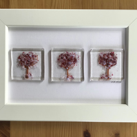 Picture. Pink trees fused glass picture in 6x4 white frame.