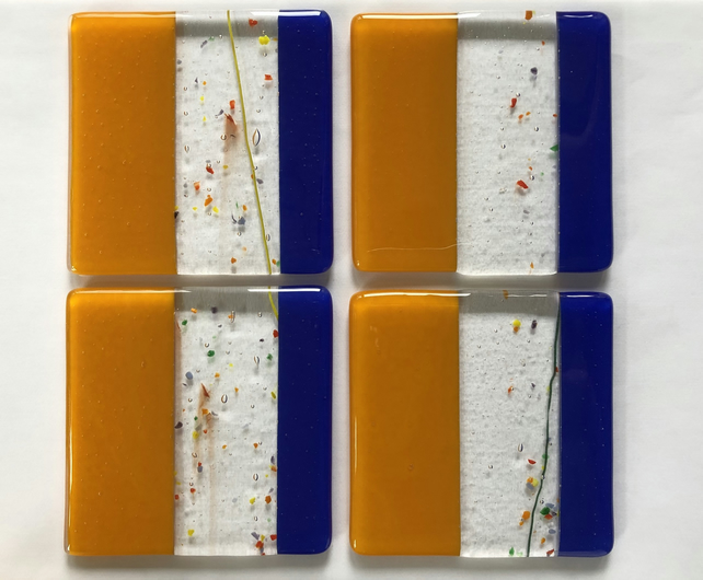 Coasters. Set of 4 orange cobalt blue and streamer fused glass coasters.