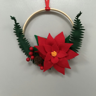 Red poinsettia bamboo wreath