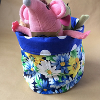 Large fabric storage basket for cosmetics, nappies and so on.