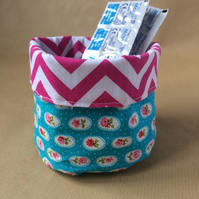 Small fabric storage basket for make up, wipes etc.