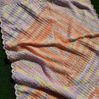Pink and peach blanket