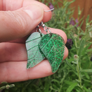 Green resin leaf shaped earrings