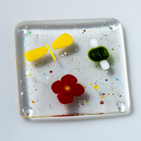 Glass coaster with butterfly, flower and beetle