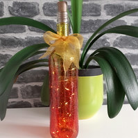 bottle lamp in flame colours, red orange yellow bottle lamp