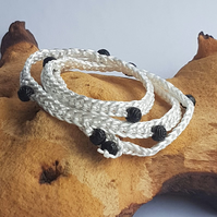 White wrap bracelet with black rose beads