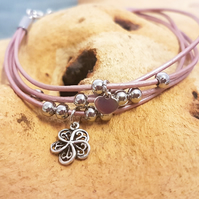 Metallic pink bracelet with flower charm