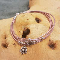 Metallic pink leather bracelet with flower charm