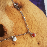 Stainless steel red stone and heart charm bracelet