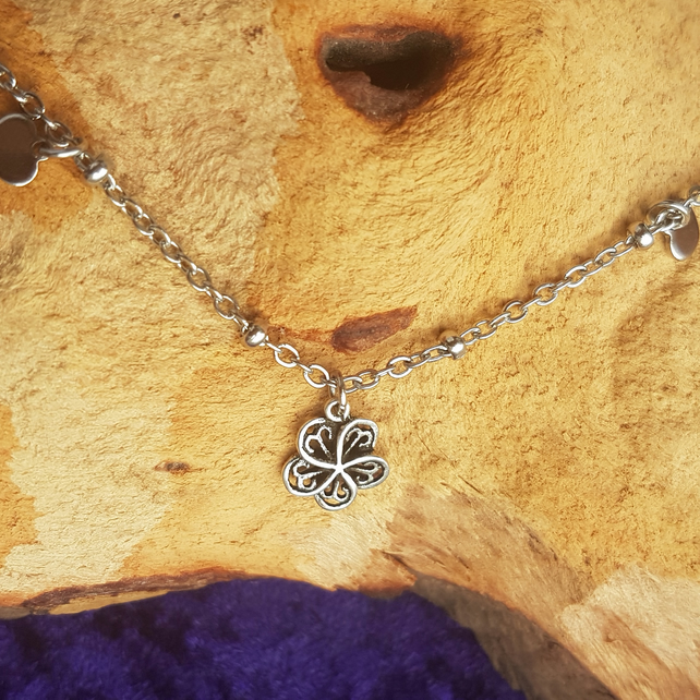 Stainless steel bracelet with flower and heart charms