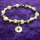 Black and white Jade stretch bracelet with compass charm