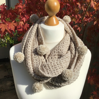Hand made Infinity scarf in acrylic yarn with matching pom poms. In parchment.