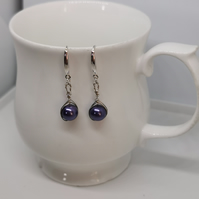 Wire wrapped purple glass bead earring, on real silver ear wire