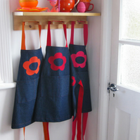 Girl's denim apron, hand-appliquéd 60's style flowers. pink, orange, red. 1-7y