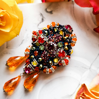 Swarovski crystal embellished beaded multi color red orange purple black brooch