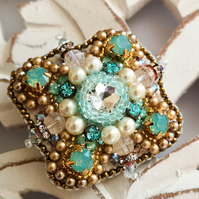 Swarovski crystal green crystal clear and vintage gold embellished beaded brooch