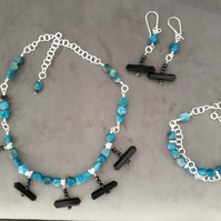Earrings, necklace and bracelet set.