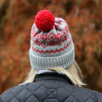 Hand knit wool bobble hat. Grey winter fairisle pompom beanie hat.