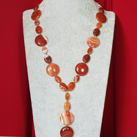 Bold and eye catching hand knotted caramel stripe agate slider necklace.