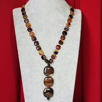 Eye catching brown stripe agate hand knotted slider necklace.