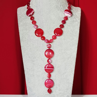 Stunning red stripe agate hand knotted necklace.