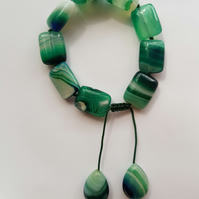 Beautiful green stripe agate hand knotted tumble bracelet