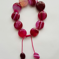 Hand knotted cerise stripe agate tumble bracelet