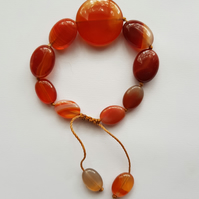 Beautiful caramel stripe agate hand knotted tumble bracelet.