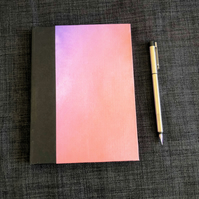 Iridescent pink and black hardback A5 notebook