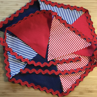 A 'quintessential' coastal handmade red and blue 8 pennant fabric bunting