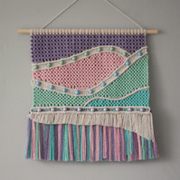 Dreamy abstract landscape macramé tapestry with coloured fringe and beads