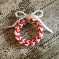 Candy cane colour knitted hanging wreath decoration