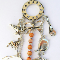 Charm pendant necklace on an 18 inch necklace, Cats eye beads, dolphins and more