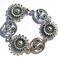 Flower Spirals bracelet, Silver colour, 8.5 Inches long, Blue Rhinetones, Magnet