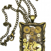 Steampunk Frame Pendant full of upcycled watch parts on a 18 inch chain necklace