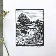 Cows on the meadow: Hand printed lino cut print by Suffolk artist Beth Knight.