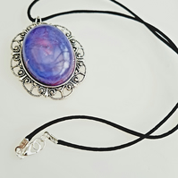 Purple smoke effect pendant, on black cord with silver plated clasp