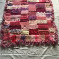 Pretty in pinks knitted blanket