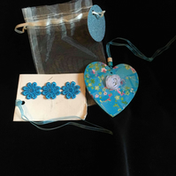 Blue floral heart in a gift bag
