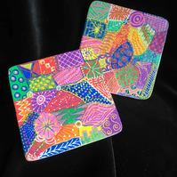 2 quirky hand painted wooden coasters