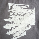 Mighty Paws - megatherium hands lino-print on black t-shirt