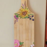 flowered Hand painted wooden cheese board .