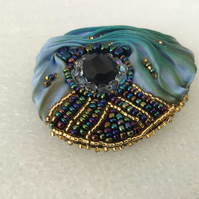 Green & blue broach with black agate & seed beads