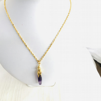 Purple amethyst shard pendant on gold plated chain
