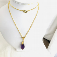 Amethyst pendant on gold plated chain