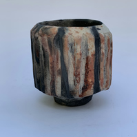 Carved, decorative pit fired pot